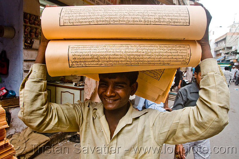 boy with load of printed paper (india), delhi, jayyed press, man, print shop, printed paper, printed sheets, printing shop, tibetan prayers, worker, working