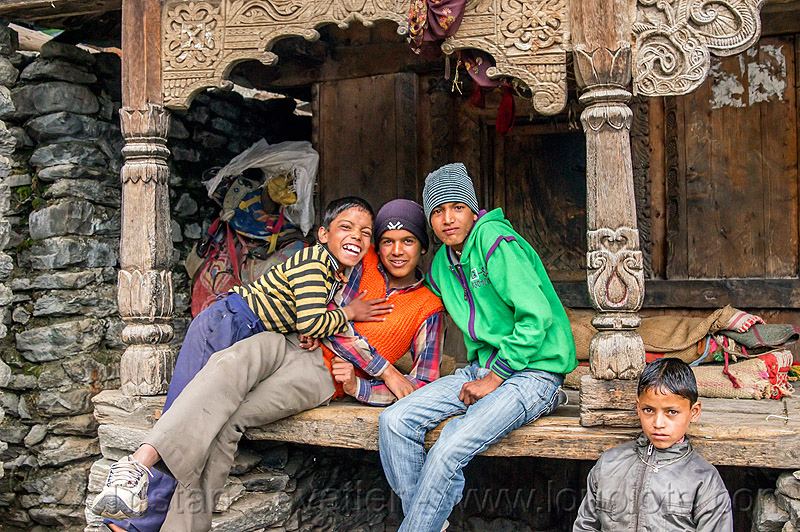 boys playing in front of old traditional house with wood carvings (india), boys, carved, children, columns, house, intricate, janki chatti, kids, knit cap, sitting, village, wood carving