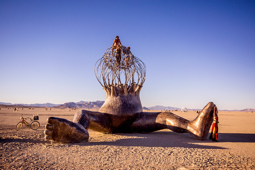 brainchild - burning man 2015, art, art installation, baby, cage, giant, giant baby, legs, metal, michael christian, people, sculpture, sitting