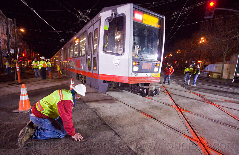 breda LRV test train, ansaldo breda, breda lrv, high-visibility jacket, high-visibility vest, light rail, man, muni, ntk, railroad construction, railroad tracks, rails, railway tracks, reflective jacket, reflective vest, safety helmet, safety vest, san francisco municipal railway, test train, track maintenance, track work, tram, worker