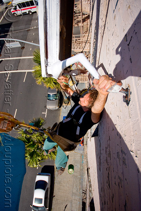 brian goggins restoring the defenestration building (san francisco), artist, cars, hanging, harness, man, paint, painting, people, restoration, rope, rope access, ropework, safety harness, street, table, wall