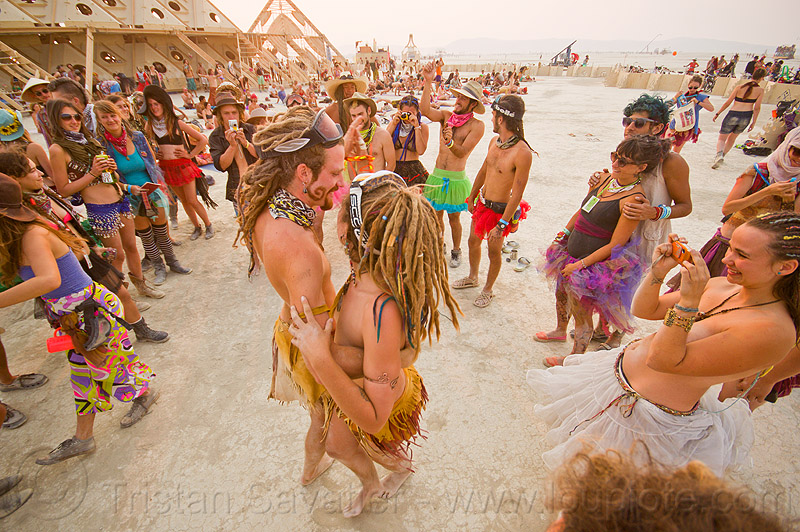 bride and groom dancing at their handfasting - burning man 2013, bride, burning man, dancing, groom, handfasting, temple of whollyness, wedding