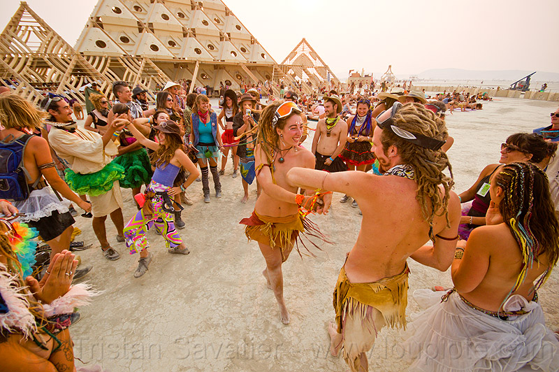 bride  and groom dancing at their handfasting - burning man 2013, couple, people, pyramid, temple, temple of whollyness, wedding, wooden pyramid