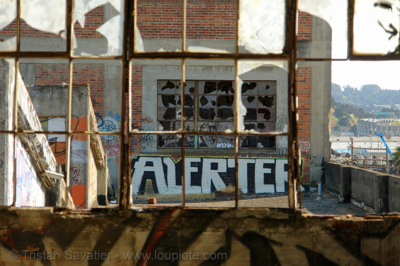 broken bay windows - abandoned factory, abandoned factory, alerter, bay windows, broken windows, derelict, graffiti piece, industrial, street art, tags, tie's warehouse, trespassing