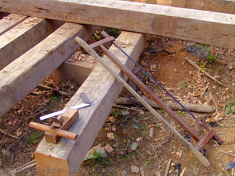 building a house - wood beams and tools - vietnam, construction, hand saw, home builders, house, lumber, timber, tools, vietnam, wood beams, wood saw