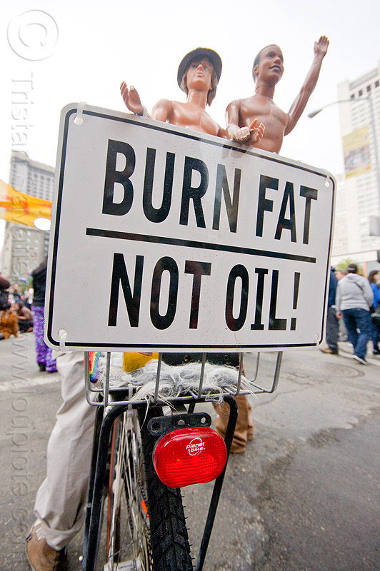 burn fat - not oil, bicycle, bike, black friday, demonstration, demonstrators, dolls, occupy, ows, people, protest, protesters, sign, street, union square