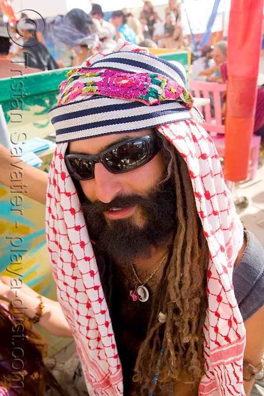 burner with dreadlocks - arabian keffiyeh - beard - burning man 2008, center camp, dreads, hat, people, sunglasses