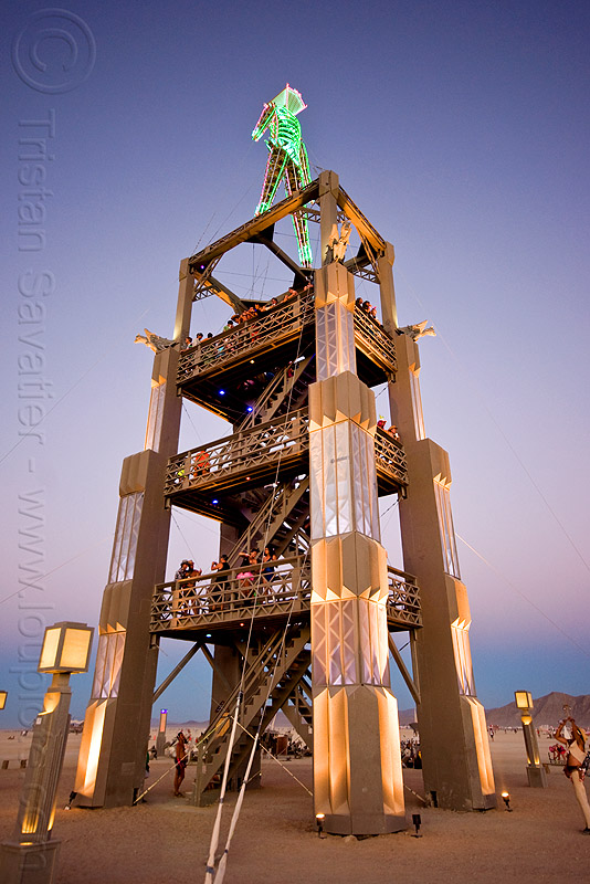 """the burning man"" on top of its art deco tower, dawn, the man"