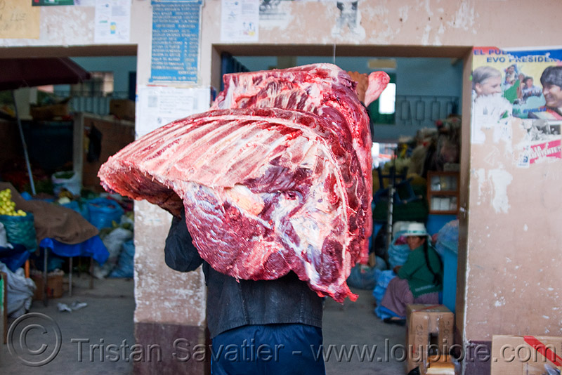 butcher carrying a quarter of beef - uyuni (bolivia), beef, bolivia, butcher, delivery, man, meat market, meat shop, raw meat, uyuni