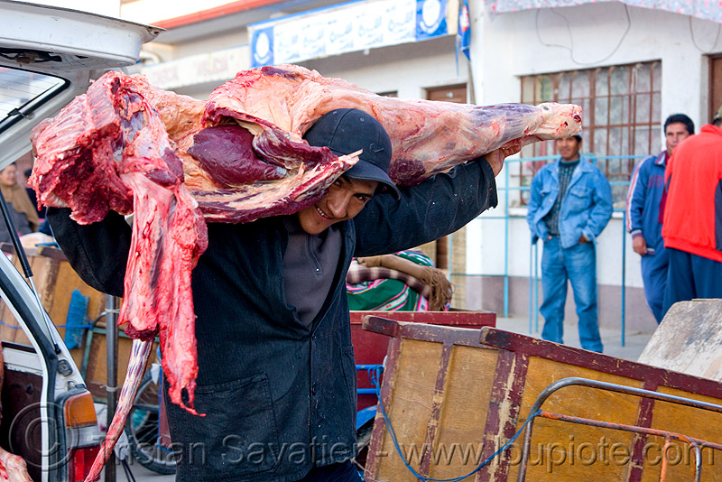 butcher carrying a quarter of beef - uyuni (bolivia), delivery, man, market, meat, meat market, meat shop, people, raw, raw meat