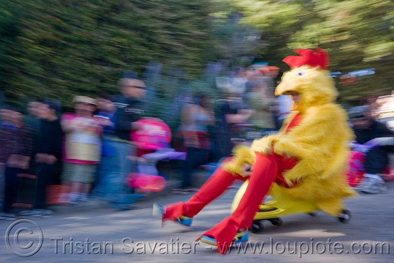 "BYOBW - ""bring your own big wheel"" race - toy tricycles (san francisco), big wheel, bird costume, chicken costume, drift trikes, moving fast, potrero hill, race, red, speed, speeding, toy tricycle, toy trike, trike-drifting, yellow"