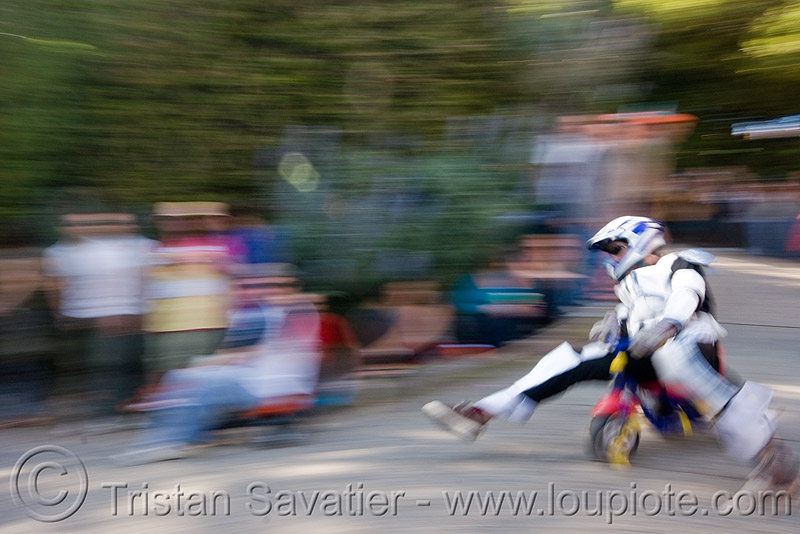 "BYOBW - ""bring your own big wheel"" race - toy tricycles (san francisco), drift trikes, fast, full face helmet, motorcycle helmet, moving, moving fast, people, potrero hill, speed, speeding, toy tricycle, toy trike, trike-drifting"