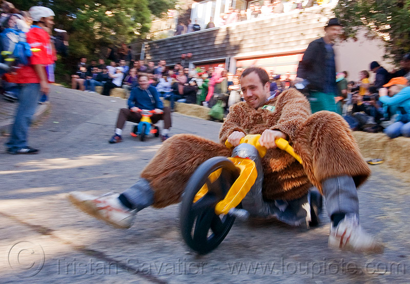 "BYOBW - ""bring your own big wheel"" race - toy tricycles (san francisco), byobw 2011, drift trikes, fast, fur costume, moving, moving fast, people, potrero hill, speed, speeding, toy tricycle, toy trike, trike-drifting"