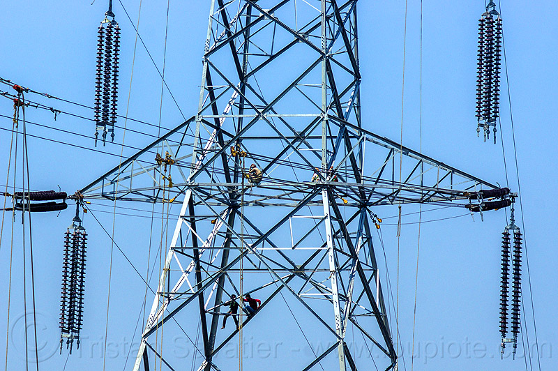 cable riggers installing power lines on transmission tower (india), cable riggers, cables, construction, electric line, electricity pylon, high voltage, industrial, infrastructure, men, power transmission lines, pulleys, rigging, safety harness, wires, workers