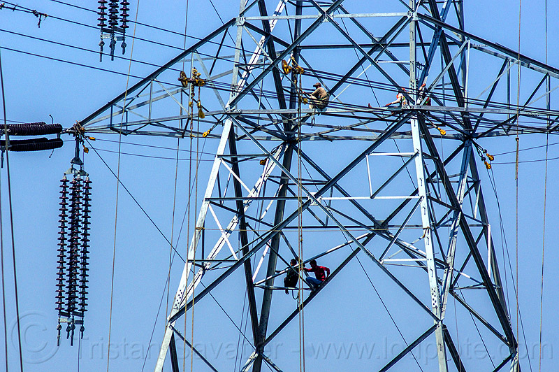 cable riggers installing power lines on transmission tower (india), cable riggers, cables, construction, electric line, electricity pylon, high voltage, india, men, power transmission lines, pulleys, rigging, safety harness, wires, workers, working