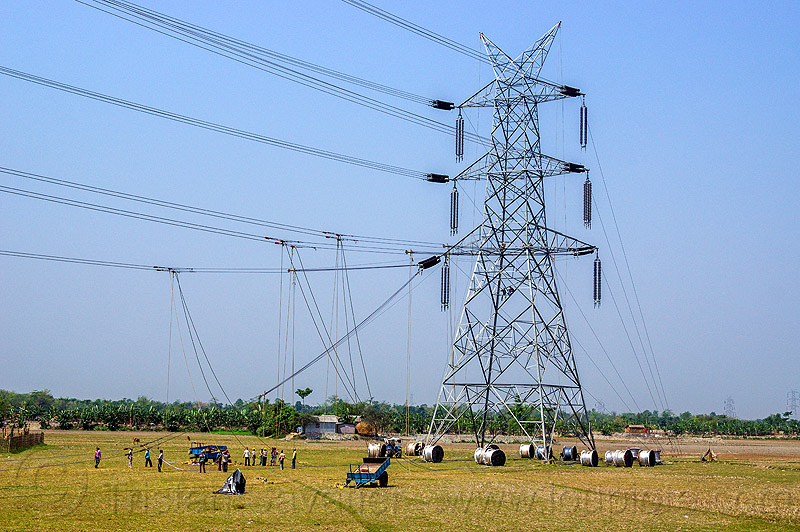 cable riggers installing power lines on transmission tower (india), cable riggers, cable wheels, cables, construction, electric line, electricity pylon, high voltage, industrial, infrastructure, men, power transmission lines, pulleys, rigging, ropes, wires, workers