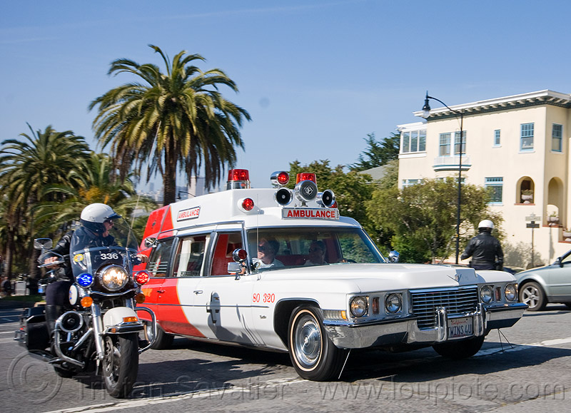 cadillac ambulance - classic car, ambulance, cadillac, classic car, harley davidson, motor cop, motor officer, motorbike, motorcycle police, motorcycle unit, procession, rider, riding, sfpd, street