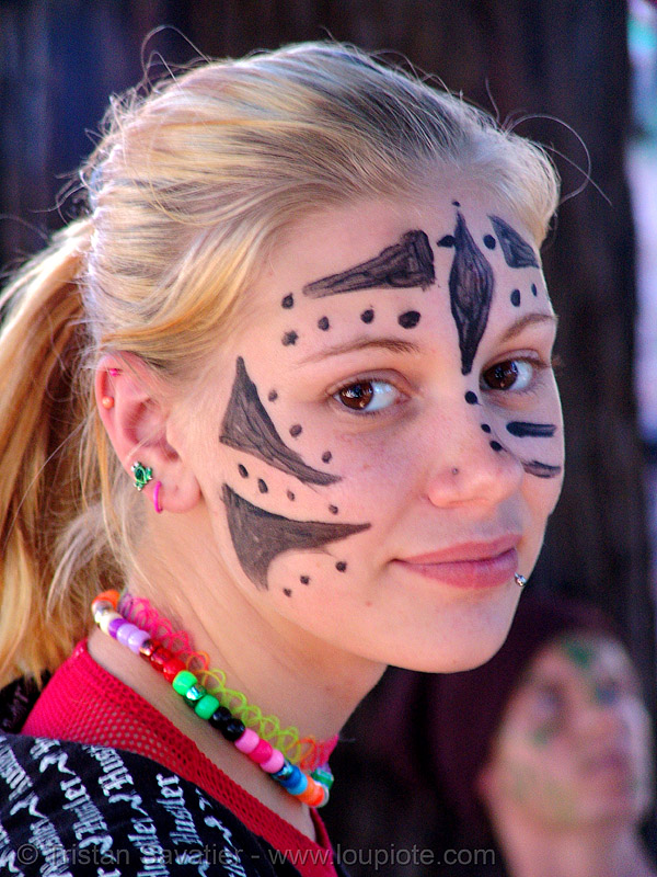 candy kid girl with face paint - burning man decompression 2007 (san francisco), beads, burning man decompression, child, face painting, facepaint, kandi kid, kandi raver, little girl, necklace, piercing, plur, raver outfits, stranger, teenager, woman