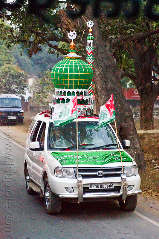 car decorated with a mosque dome and minaret on its roof - eid-milad-un-nabi muslim festival (india), decorated car, dome, eid-e-milad-un-nabi, eid-e-milād-un-nabī, eid-milad-un-nabi, flags, islam, mawlid, milad un-nabi, milad-an-nabi, milād an-nabī, milād un-nabī, minaret, mohammed's birthday, mosque, muhammad's birthday, muslim festival, nabi day, prophet's birthday, religion, street, tata motors, عید میلاد النبی, ईद मिलाद नबी