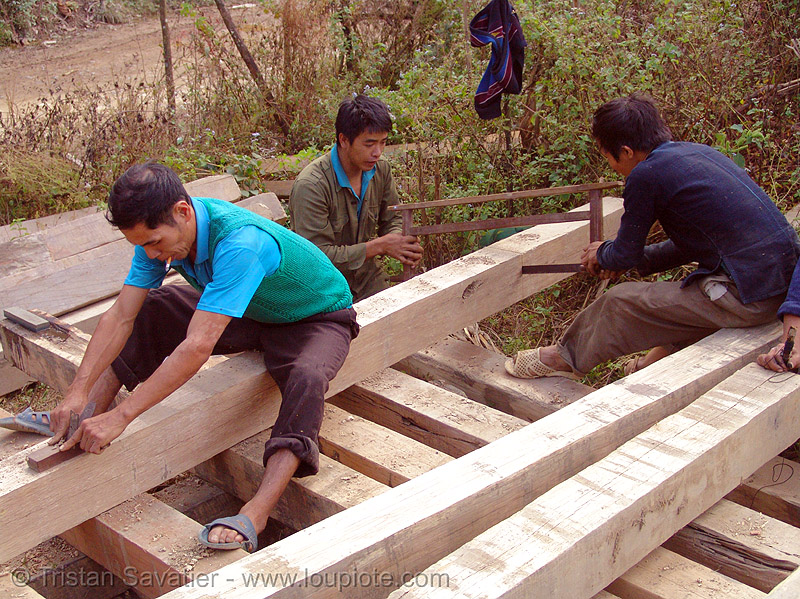 carpenters working on wood beams - vietnam, carpenters, construction workers, home builders, house, men, tools, vietnam, wood beams, wood saw, working