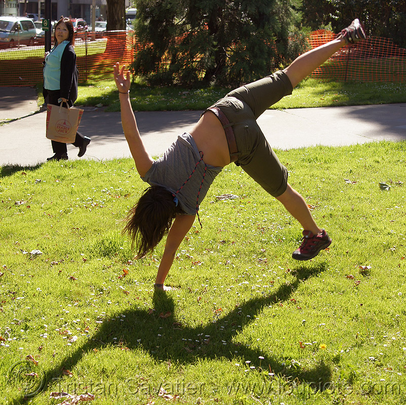 cartwheeling on one hand, cartwheeling, catrwheel, grass, gymnastics, jessika, lawn, one hand, single handed, upside-down, woman