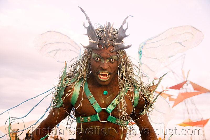 cat-eye contact lenses - vampire - burning man 2008, african american man, black man, burning man, cat-eye contact lenses, color contact lenses, contacts, special effects contact lenses, teeth, theatrical contact lenses, vampire fangs