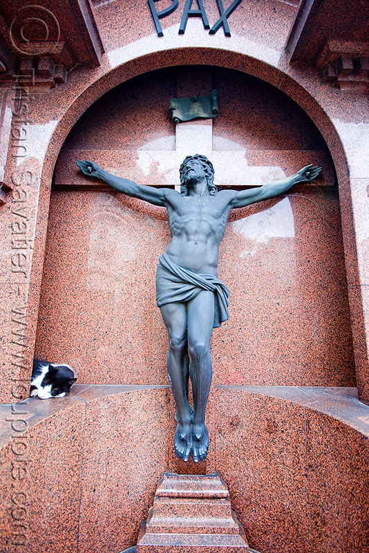 cat sleeping near crucifix - recoleta cemetery (buenos aires), buenos aires, cat, christ, corpus, crucifix, grave, graveyard, jesus, pax, recoleta cemetery, religion, tomb