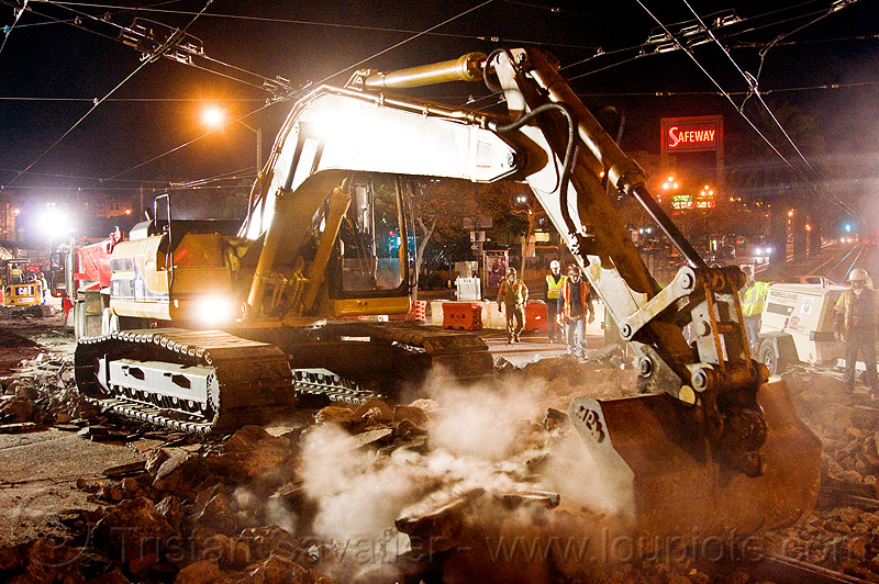 caterpillar 322L excavator, at work, cat 322l, caterpillar, demolition, dust, excavator, heavy equipment, high-visibility jacket, high-visibility vest, light rail, machinery, man, muni, night, ntk, overhead lines, railroad construction, railroad tracks, rails, railway tracks, reflective jacket, reflective vest, safety glasses, safety helmet, safety vest, san francisco municipal railway, track maintenance, track work, worker, working