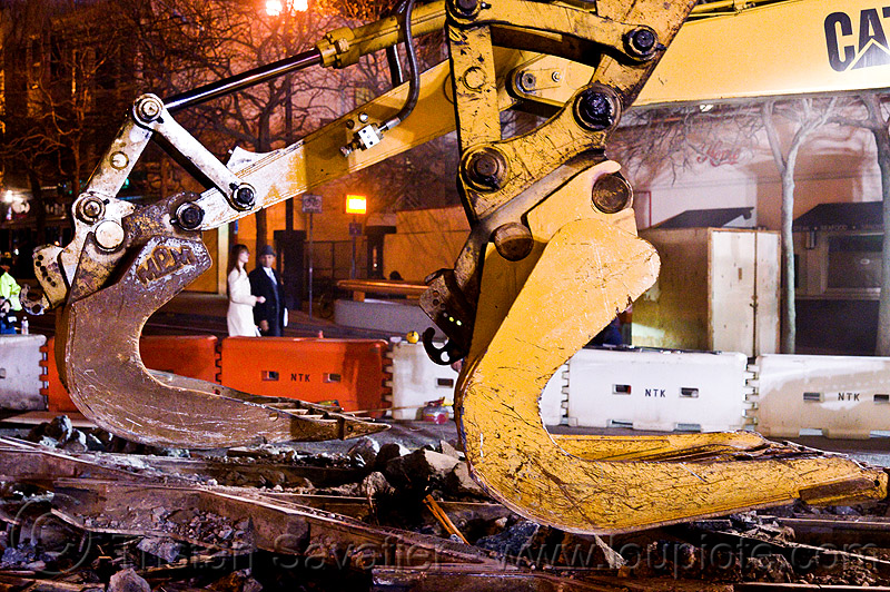 caterpillar 322L excavator shovel attachments, at work, cat 322l, caterpillar, demolition, excavators, heavy equipment, light rail, machinery, muni, ntk, railroad construction, railroad tracks, rails, railway tracks, san francisco municipal railway, track maintenance, track work, working