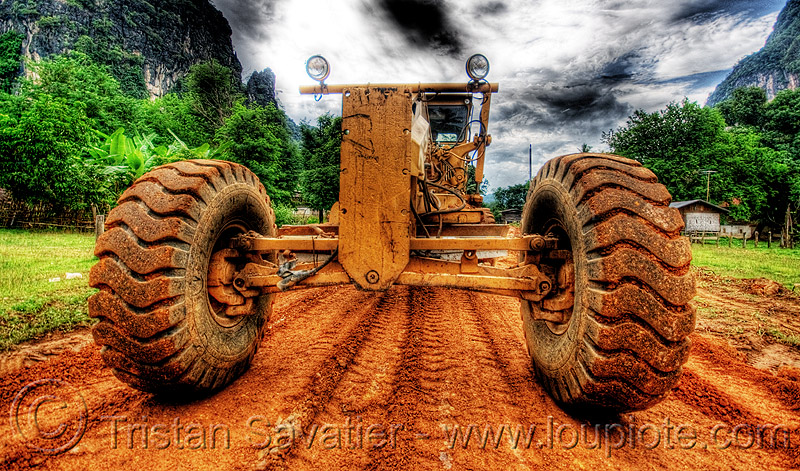 caterpillar CAT 14G (140G) grader - road construction (laos), at work, cat 14g, cat grader, caterpillar 140g, caterpillar 14g road grader, caterpillar road grader, engine, groundwork, heavy equipment, hydraulic, machinery, motor grader, mud tires, preparation, road construction, roadworks, wheels, working, yellow