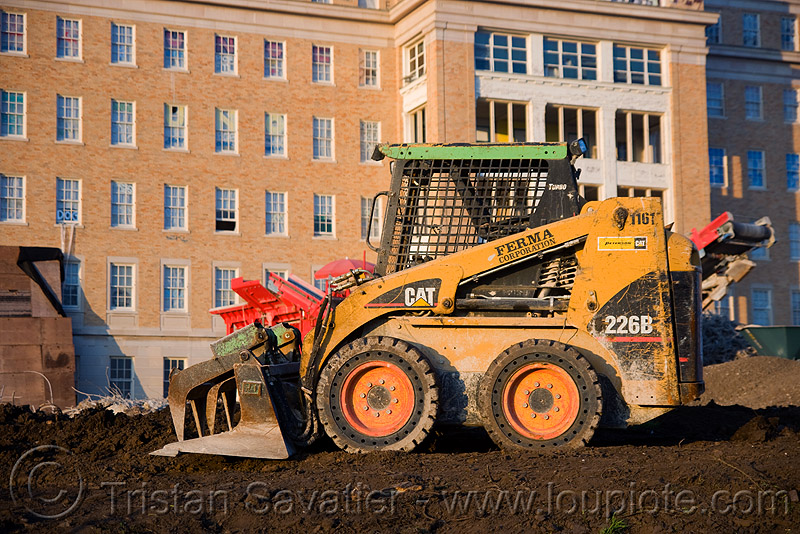 caterpillar CAT 226B skid steer loader, abandoned building, abandoned hospital, building demolition, cat 226b, caterpillar 226b, front loader, heavy equipment, hydraulic, machinery, presidio hospital, presidio landmark apartments, skid steer loader