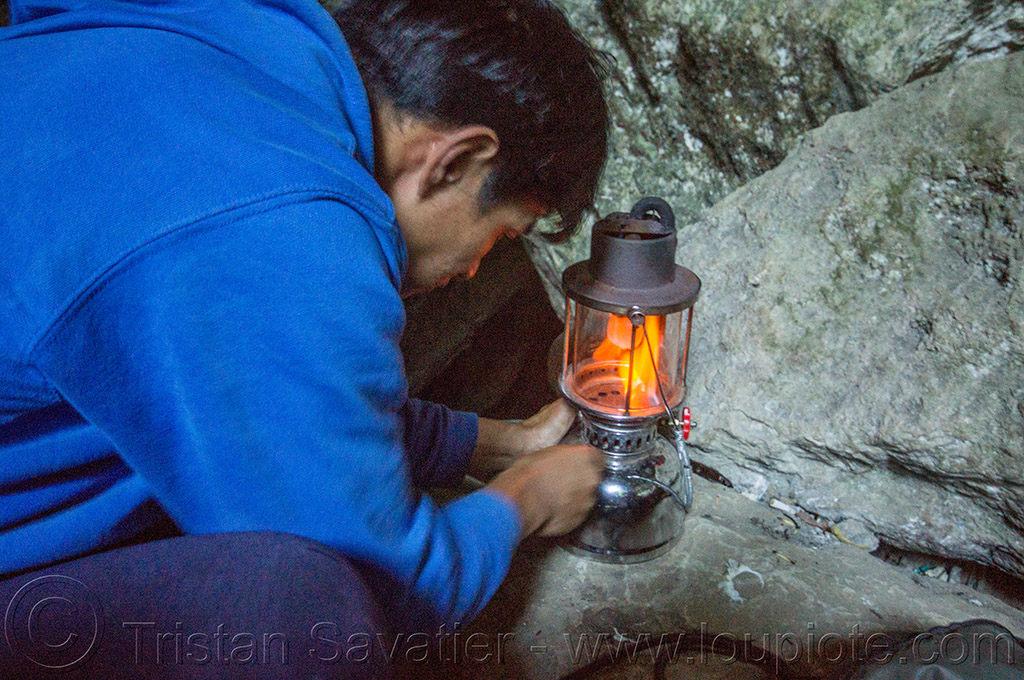 cave guide lits-up kerosene lamp - lumiang cave - sagada (philippines), guide, lamp, lumiang cave, man, natural cave, philippines, sagada