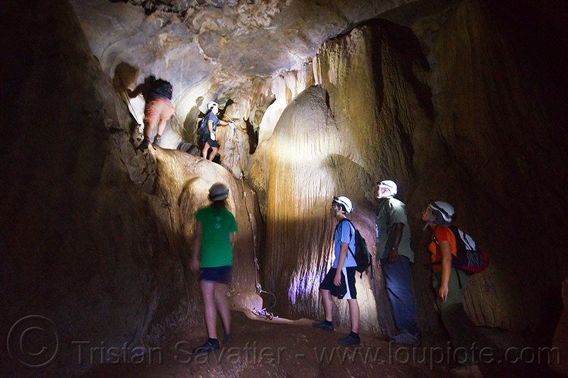 caving in mulu - racer cave (borneo), cave formations, cavers, caving, concretions, gunung mulu national park, knotted rope, natural cave, racer cave, speleothems, spelunkers, spelunking, wall