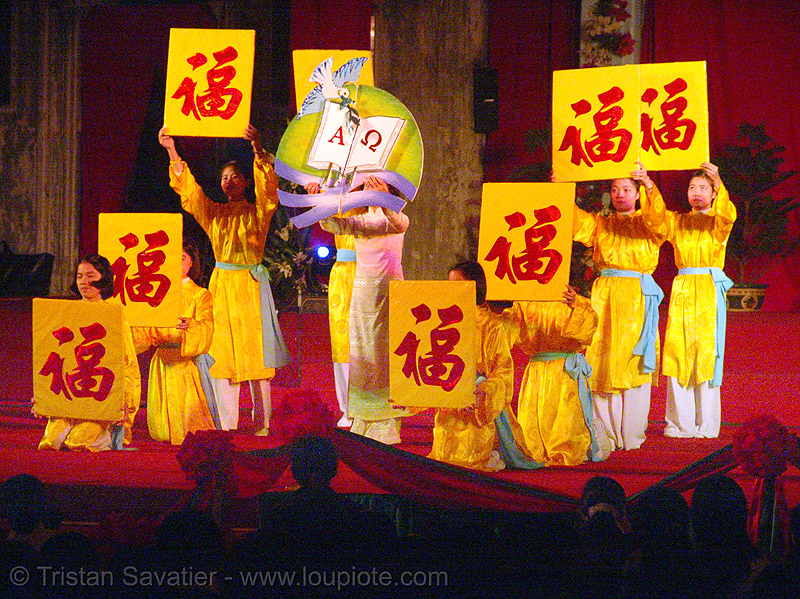 celebration in front of the cathedral - vietnam, cathedral, chinese, church, hanoi, ideograms, red, signs, vietnam, yellow