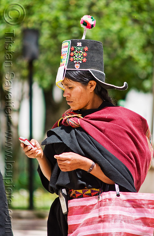 cellphone used by tribe - (bolivia), cellphone, hat, indigenous, pom-poms, pom-pons, quechua, tarabuco, woman