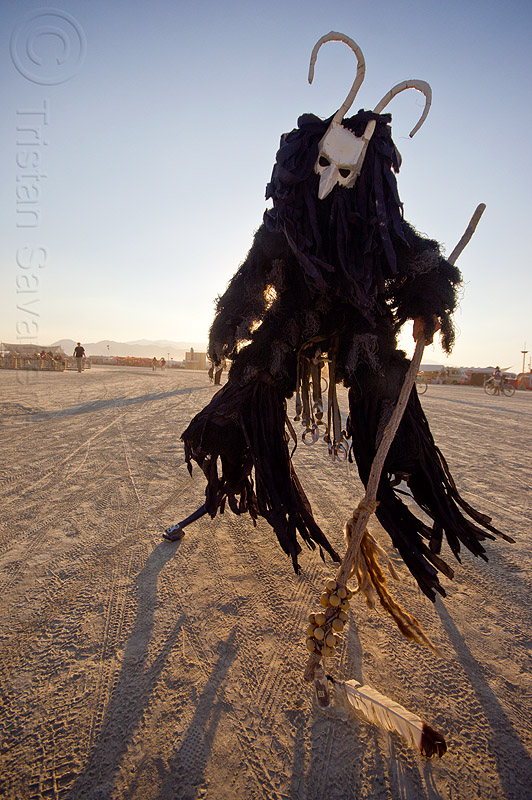 cernunnos - horned god - burning man 2013, cane, celtic deity, ceremonial staff, ceremonial stick, costume, demonic, evil spirit, horns, mask, masked, people, performance, shaman, stilter, stilts