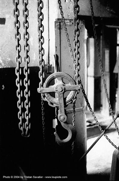 chain pulley - grands moulins de paris - chaines, abandoned, decay, hook, industrial mill, trespassing, urban exploration, stock photo