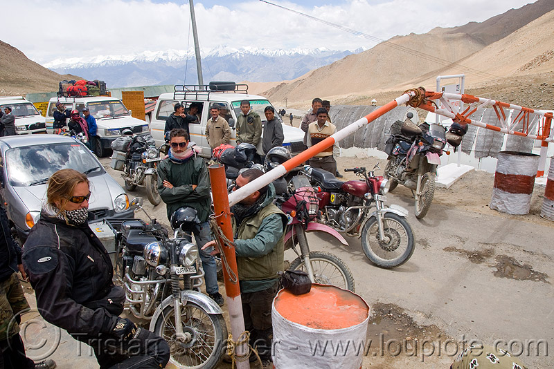 check-point - khardungla pass - ladakh (india), check-point, dual-sport, fence, india, kawasaki, khardung la pass, klr 650, ladakh, motorcycle touring, mountain pass, road, royal enfield bullet