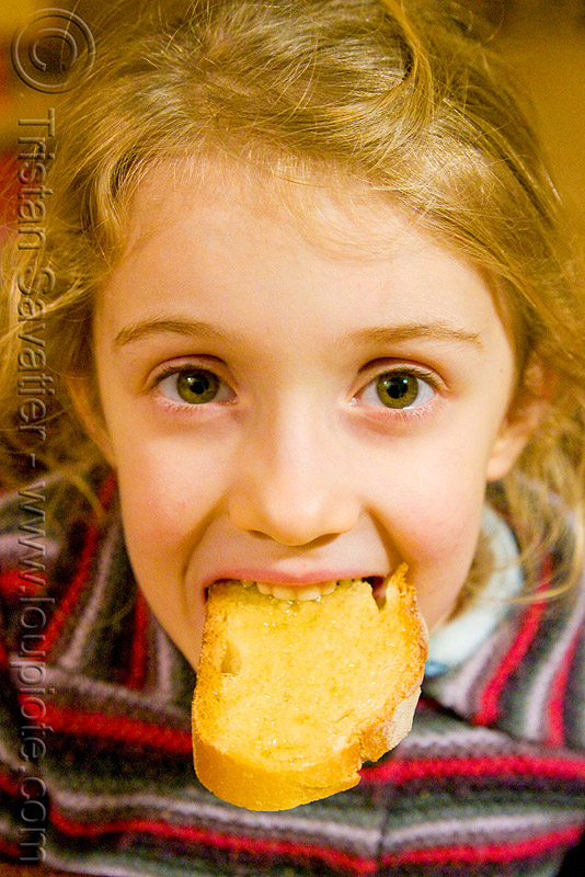 child devouring honey toast, apolline, blonde, bread, breakfast, eating, girl, kid, little girl, mouth, people, teeth, toasted bread