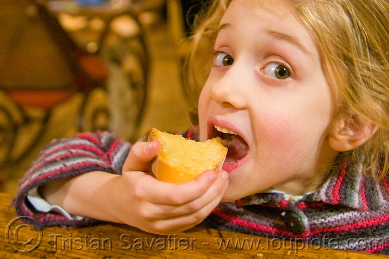 child eating honey toast, apolline, blonde, bread, breakfast, girl, kid, little girl, mouth, people, teeth, toasted bread