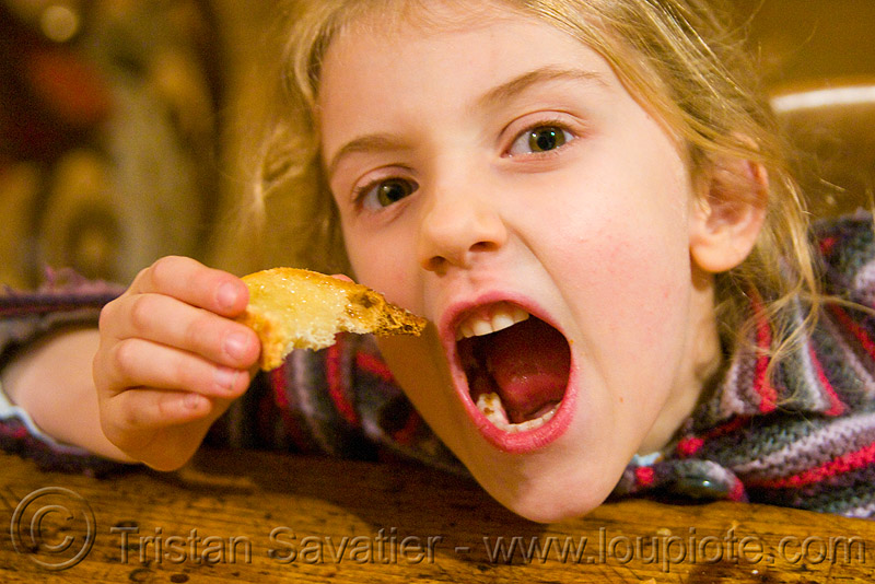 child and honey toast, apolline, blonde, bread, breakfast, devouring, eating, girl, kid, little girl, making faces, mouth, people, teeth, toasted bread