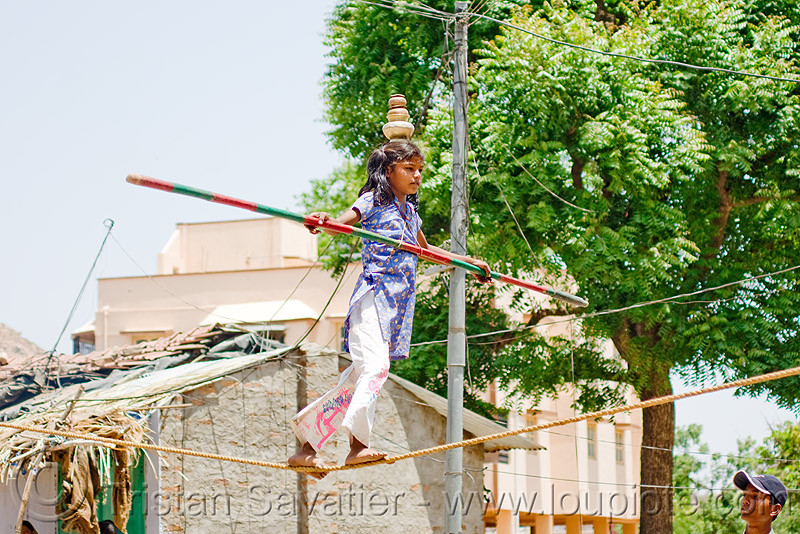 circus performer in village - young girl balancing on slack rope - near udaipur (india), artist, balancing, circus, girl, performer, slack rope, staff, udaipur