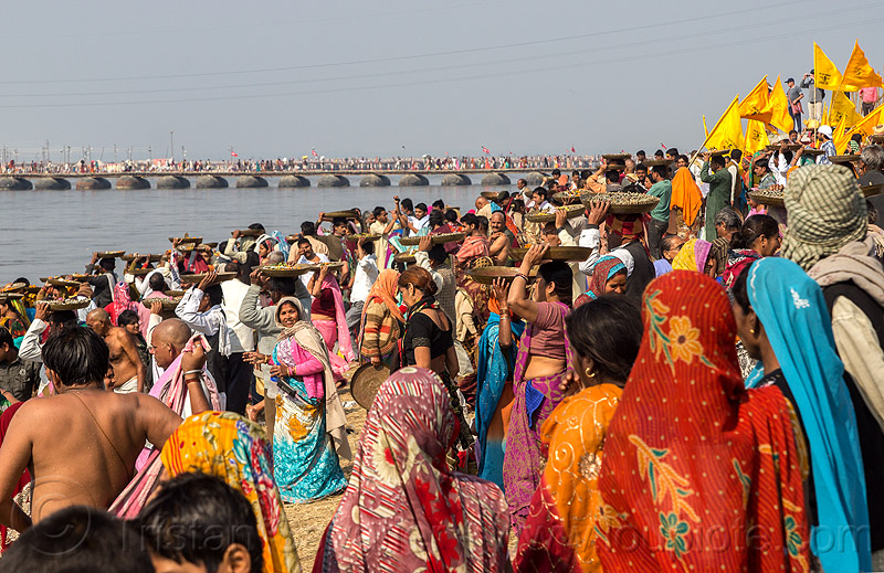 clay shiva linga's offering ceremony - kumbh mela festival (india), carrying on the head, clay, crowd, ganga river, ganges river, hindu ceremony, hinduism, kumbha mela, lingams, lingas, maha kumbh mela, offerings, procession, river bank, shiva, trays, walking, water