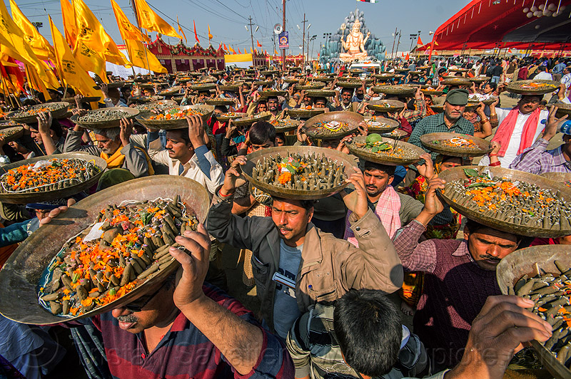 clay shiva lingam's hindu offerings - kumbh mela (india), carrying on the head, clay, crowd, hindu ceremony, hindu pilgrimage, hinduism, india, lingams, maha kumbh mela, offerings, shiva lingam, trays, walking, yellow flags