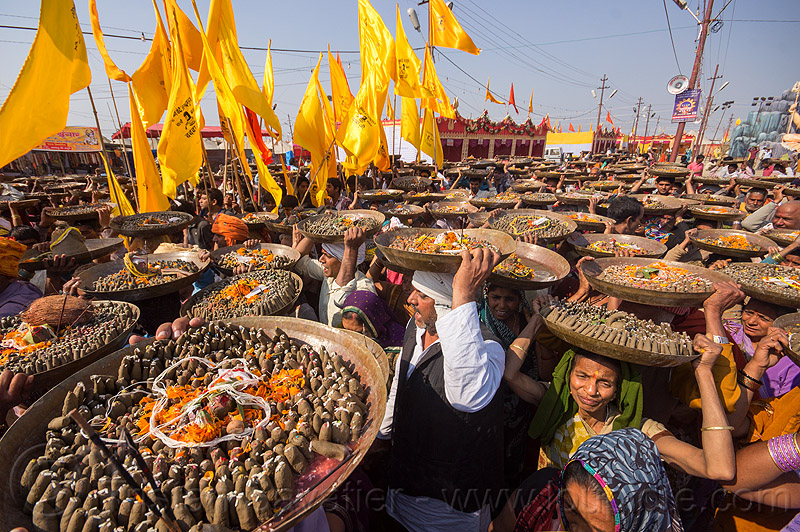 clay shiva lingas hindu offerings - procession at kumbh mela (india), carrying on the head, clay, crowd, hindu ceremony, hindu pilgrimage, hinduism, india, lingams, maha kumbh mela, offerings, shiva lingam, trays, walking, yellow flags