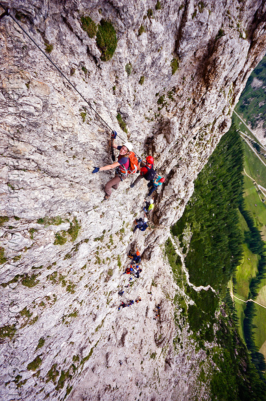 cliff climbing - ascending the via ferrata tridentina - dolomites mountains (italian alps), alps, cliff, climber, climbing harness, climbing helmet, dolomites, dolomiti, ferrata tridentina, mountain climbing, mountaineer, mountaineering, mountains, rock climbing, vertical, via ferrata brigata tridentina, woman