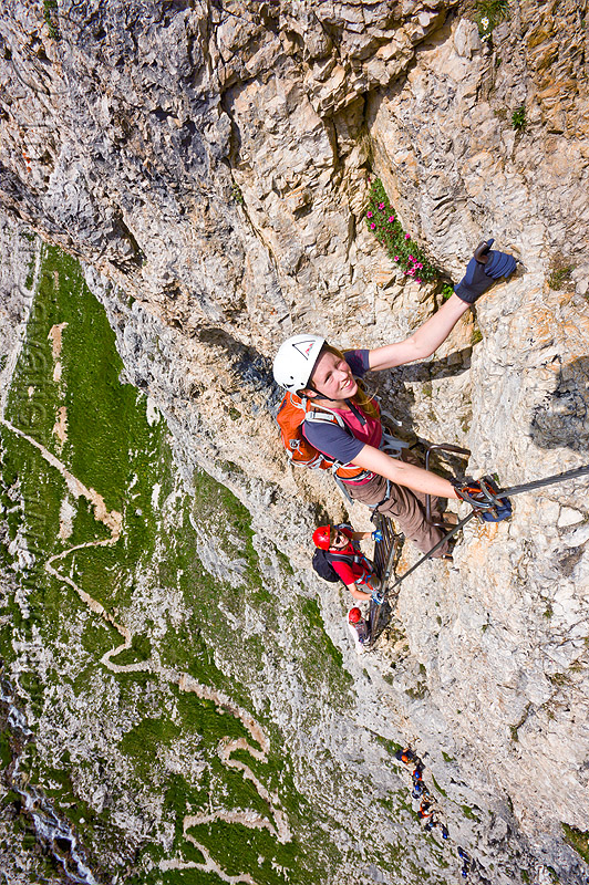 cliff climbing - via ferrata, alps, cliff, climber, climbing harness, climbing helmet, dolomites, dolomiti, ferrata tridentina, mountain climbing, mountaineer, mountaineering, mountains, rock climbing, vertical, via ferrata brigata tridentina, woman