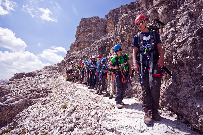 climbers in line - monte paterno via ferrata, alps, climbers, climbing harness, climbing helmet, dolomites, line, lined-up, montaineers, monte paterno, mountain climbing, mountaineer, mountaineering, mountains, parco naturale dolomiti di sesto, rock climbing, trail, via ferrata, waiting