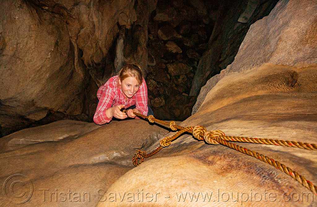 climbing a flowstone - lumiang / sumaguing cave - sagada (philippines), cave formations, cavers, caving, climbing, concretions, flowstone, knotted rope, lumiang cave, natural cave, philippines, sagada, speleothems, spelunkers, spelunking, sumaguing cave
