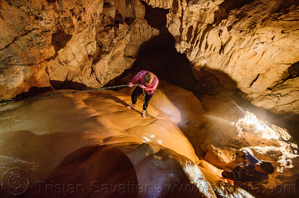 climbing a flowstone - sumaguing cave - sagada (philippines), cave formations, cavers, caving, climbing, concretions, flowstone, knotted rope, natural cave, philippines, sagada, speleothems, spelunkers, spelunking, sumaguing cave
